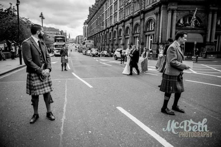 Bride crossing Lothian road in Edinburgh