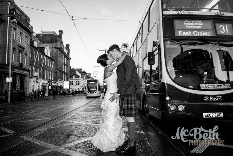 bride and groom on Edinburgh's princes street